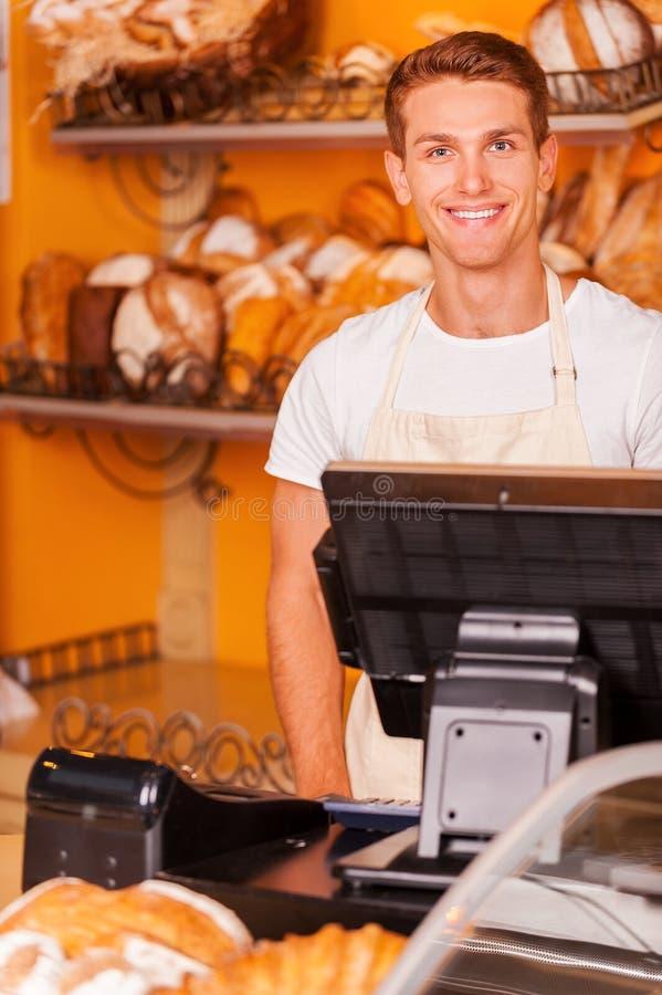 Confident cashier. royalty free stock photos