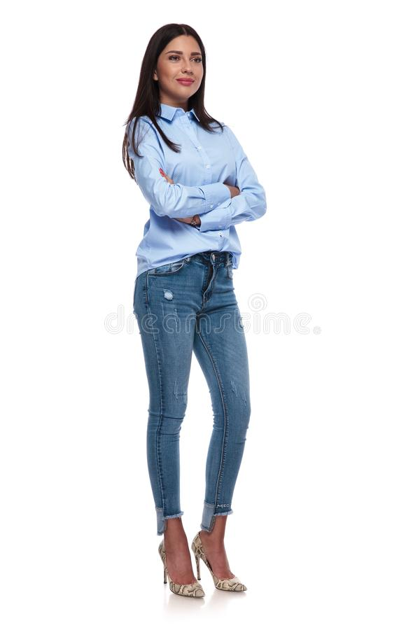 Confident casual woman standing and looking to side stock photo