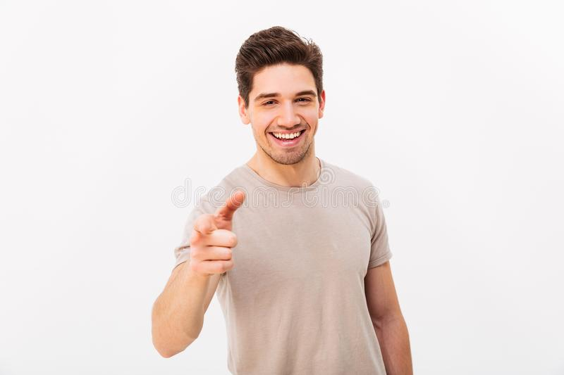 Confident cheerful man with brown hair gesturing index finger on stock image