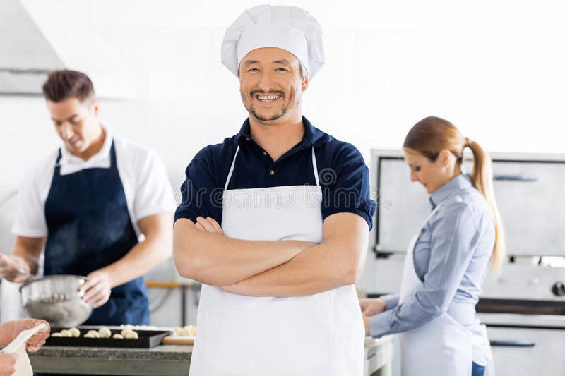 Confident Chef Standing Arms Crossed While stock photo