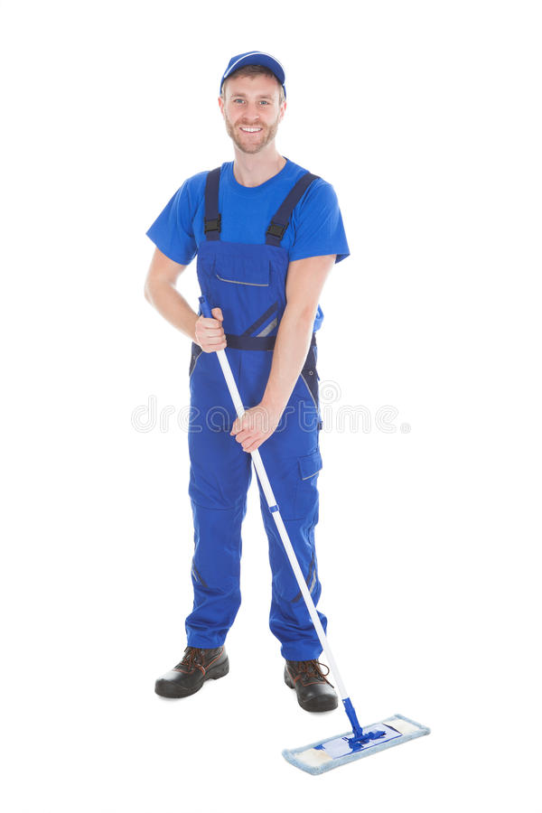 Confident Cleaner Mopping Over White Background royalty free stock photography