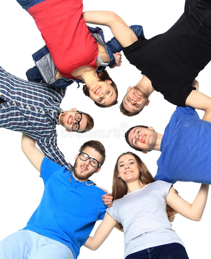 Confident college students forming huddle over white background stock images
