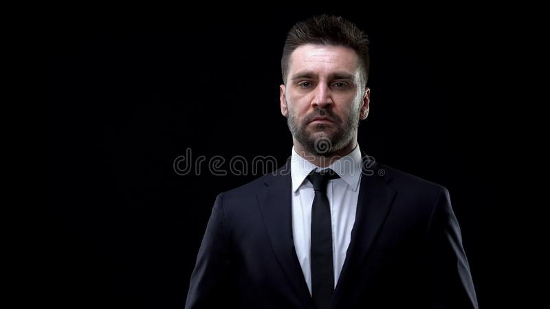 Confident company boss in formal suit looking in camera, successful politician. Stock photo stock photography