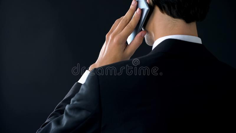 Confident company director talking phone back view, appointing partner meeting royalty free stock photo