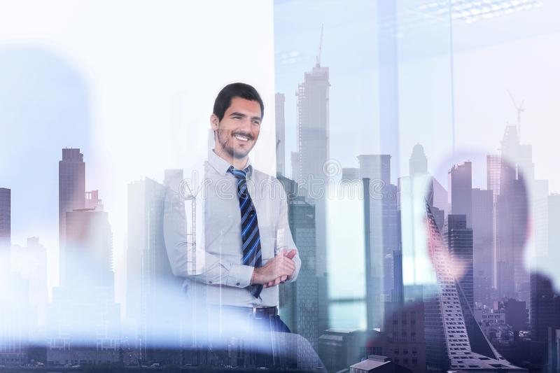 Confident company leader on business meeting against new york city manhattan buildings and skyscrapers window reflection royalty free stock image