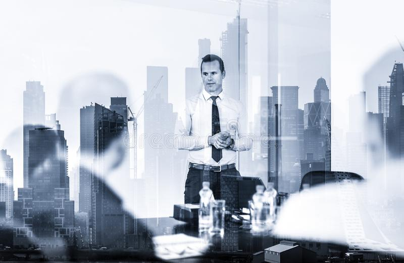 Confident company leader on business meeting against new york city manhattan buildings and skyscrapers window reflection royalty free stock photography