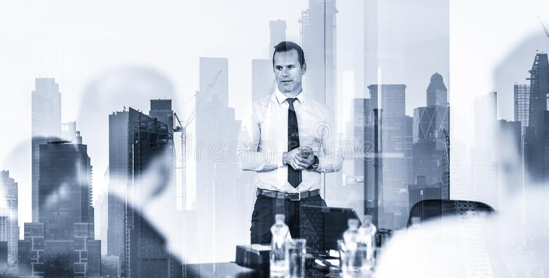 Confident company leader on business meeting against new york city manhattan buildings and skyscrapers window reflection stock photo