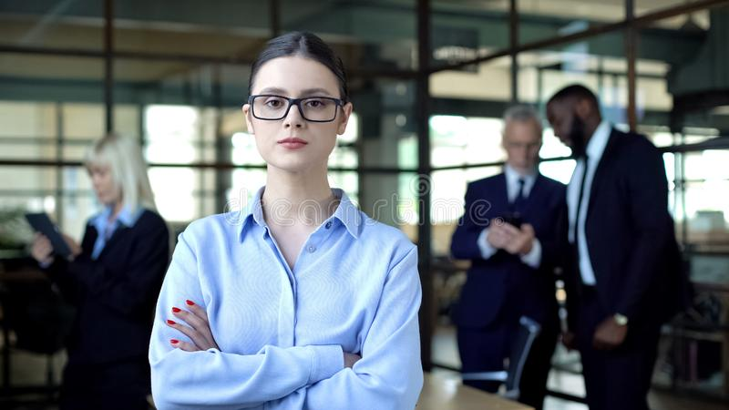 Confident company manager in eyeglasses folded arms looking camera, occupation stock photos