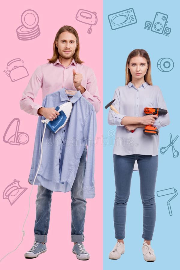 Confident couple standing together and getting ready for doing housework stock photos