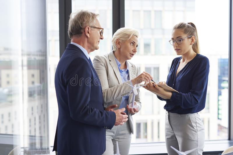 Confident coworker convincing about her opinion. During meeting in the office stock photos