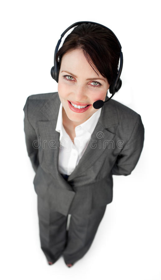 Confident customer service agent using a headset. Against a white background royalty free stock photo