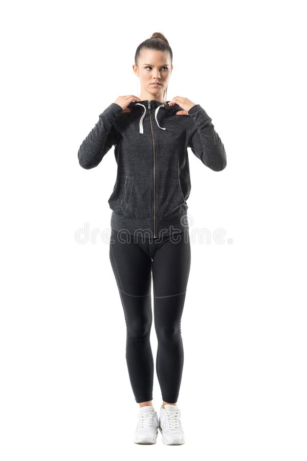 Confident determined female jogger get prepared for training looking away stock images