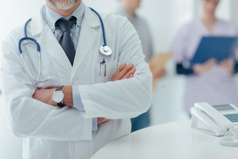 Confident doctor at the reception desk stock image