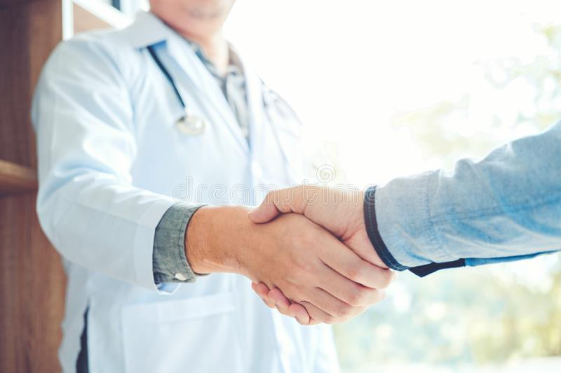 Confident Doctor shaking hands with patients talk in the hospital.  royalty free stock photo