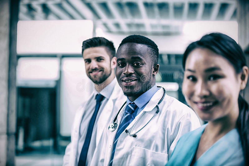 Confident doctor standing with colleagues stock images