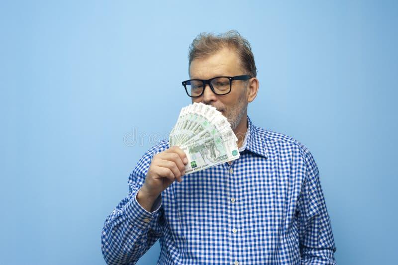 Confident elderly businessman with glasses stock image