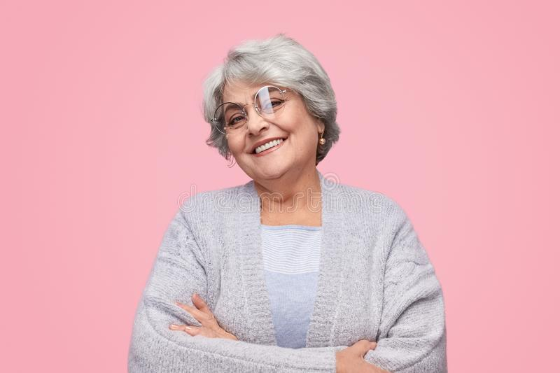 Confident elderly lady looking at camera stock photos