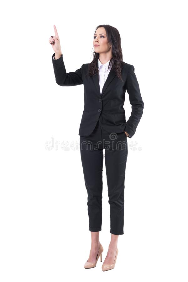 Confident elegant business woman pointing finger touching virtual reality push button screen. Full body isolated on white background royalty free stock images