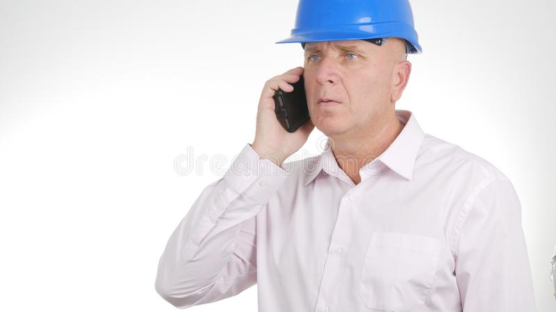 Confident Engineer Image Talking Business on Cellphone stock photography