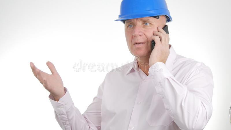Confident Engineer Image Talking Business to Cellphone stock photo