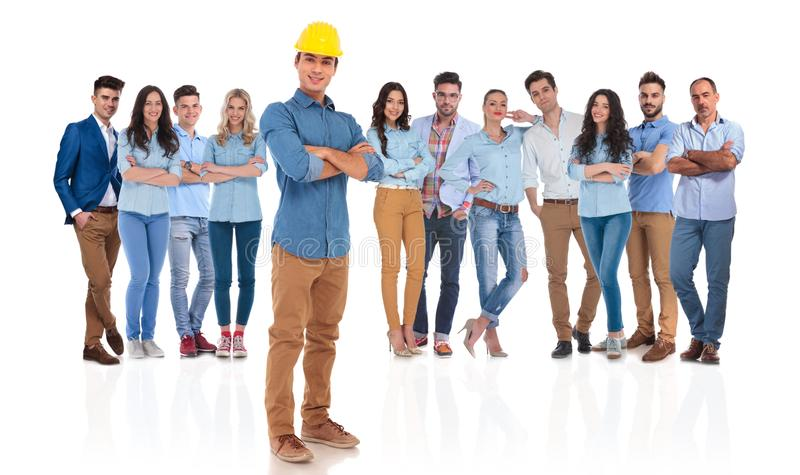 Confident engineer team leader standing in front of his group stock photos
