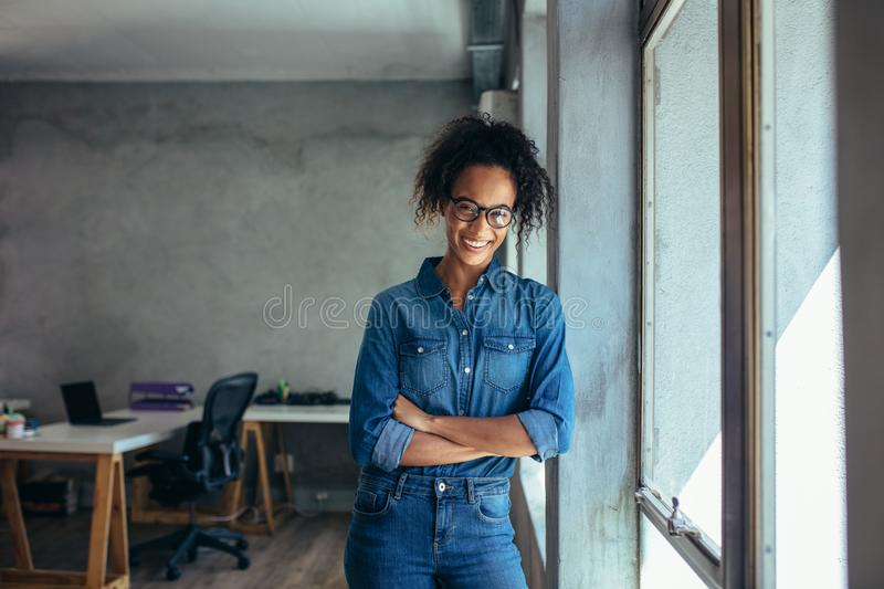 Confident entrepreneur in her office royalty free stock photos