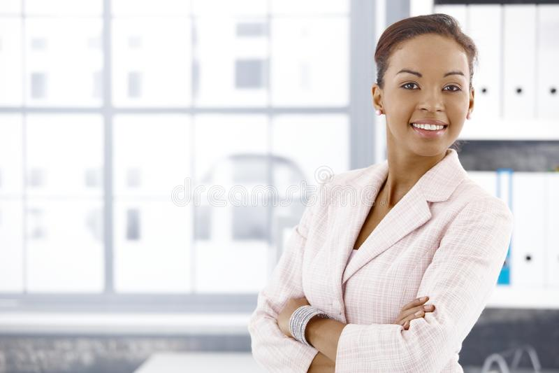 Confident ethnic businesswoman in office royalty free stock photography