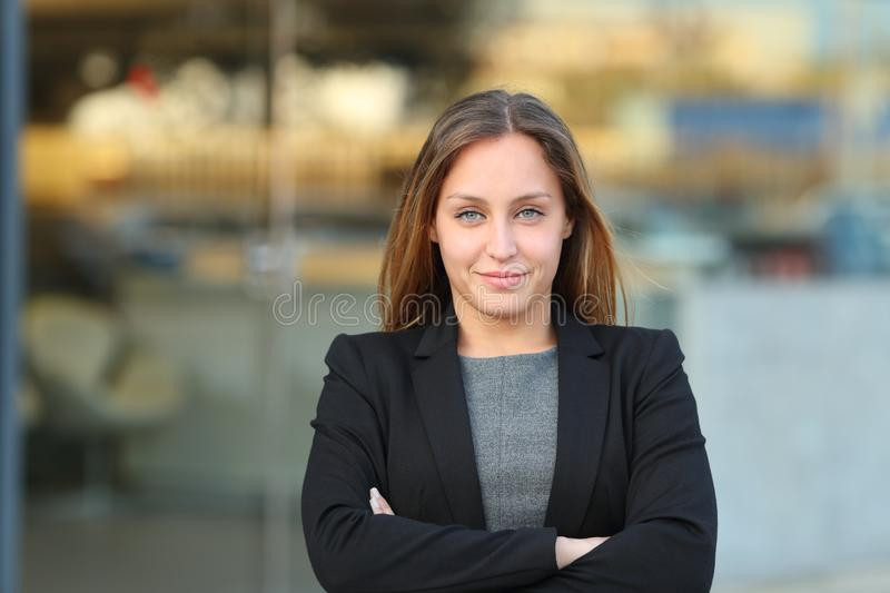 Confident executive looking at camera folding arms royalty free stock images