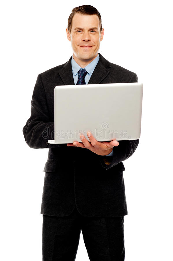 Download Confident Executive Using Laptop And Surfing Web Stock Image - Image: 25883791