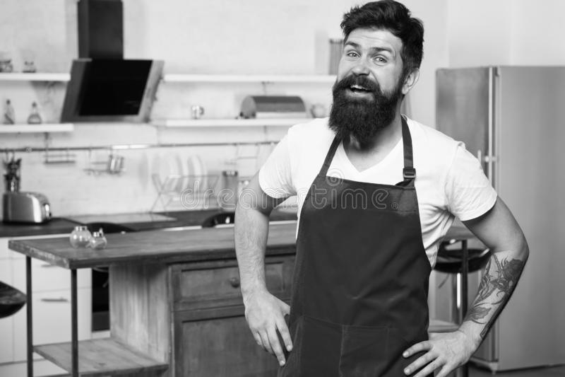 Confident and experienced chef. Hipster in kitchen. Mature male. Bearded man cook. Restaurant or cafe cook. Bearded man stock image