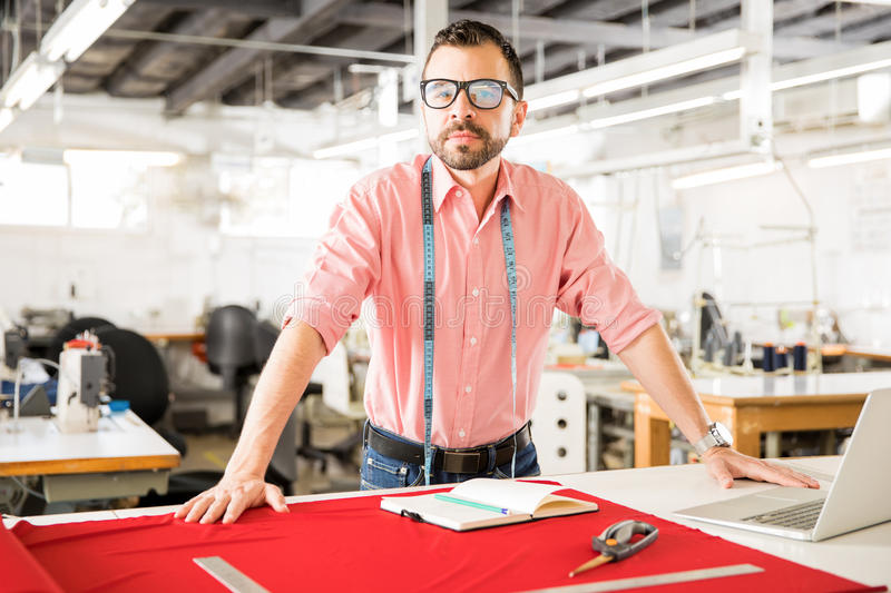 Confident fashion designer at work stock photography
