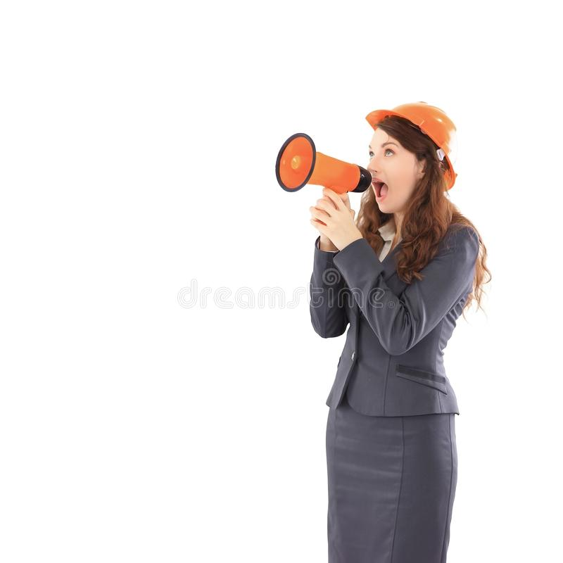 Confident female architect - engineer shouts into a megaphone a megaphone. stock photography