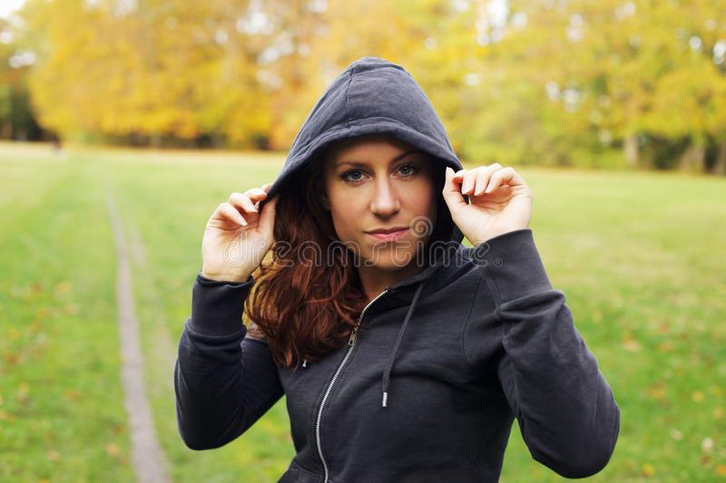 Confident female athlete in hoodie royalty free stock image