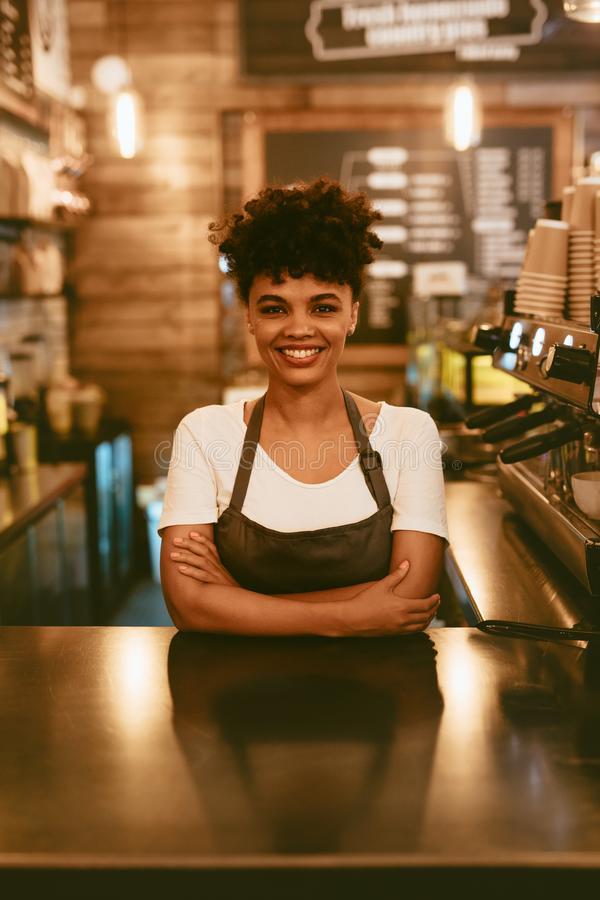 Confident female barista royalty free stock photography