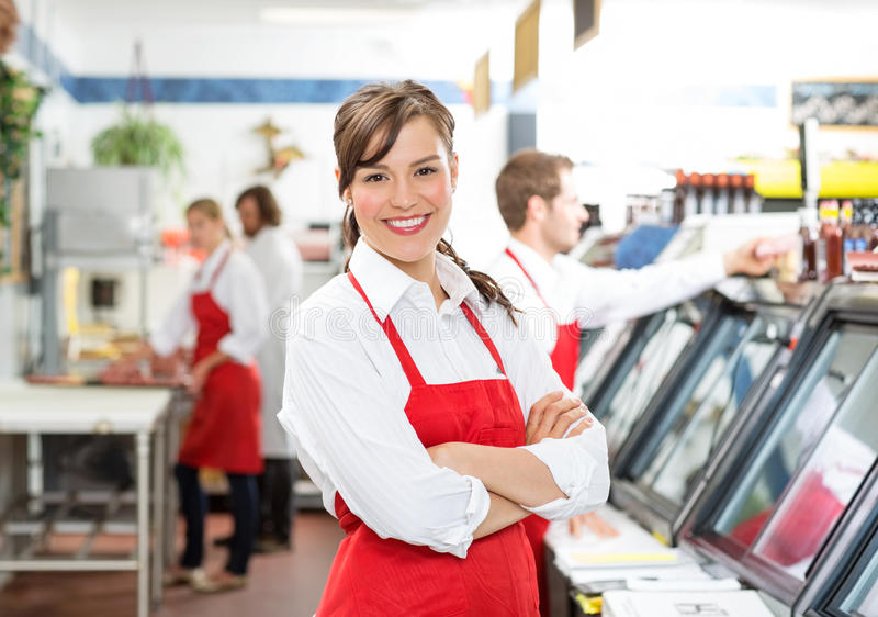 Confident Female Butcher Standing Arms Crossed stock photos