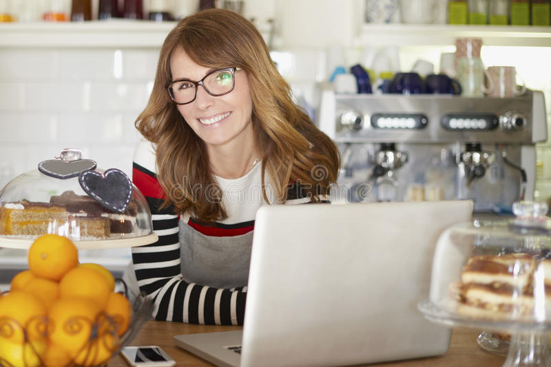 Confident female cafe owner stock images