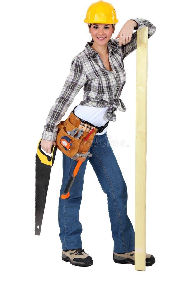Confident female carpenter royalty free stock photo