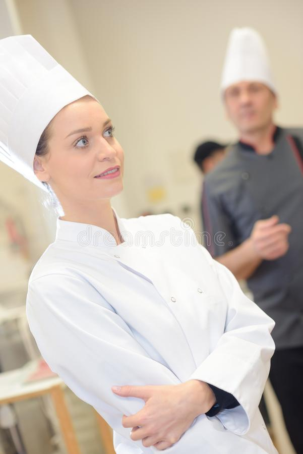 Confident female chef in commercial kitchen. Female stock photos