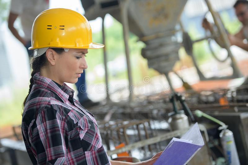 Confident female engineer in shipping yard royalty free stock image