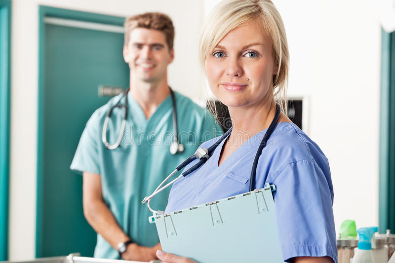 Confident female and male veterinarian stock image
