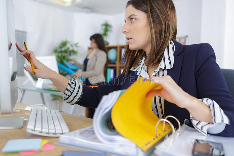 Confident female office manager at workplace royalty free stock photo
