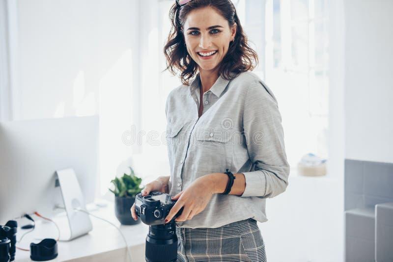 Confident female photographer stock images