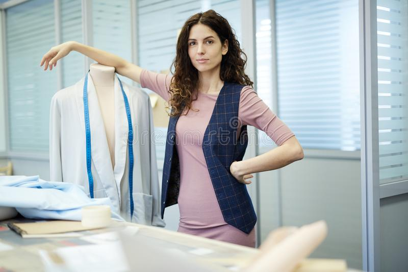Confident female tailor in atelier stock photos