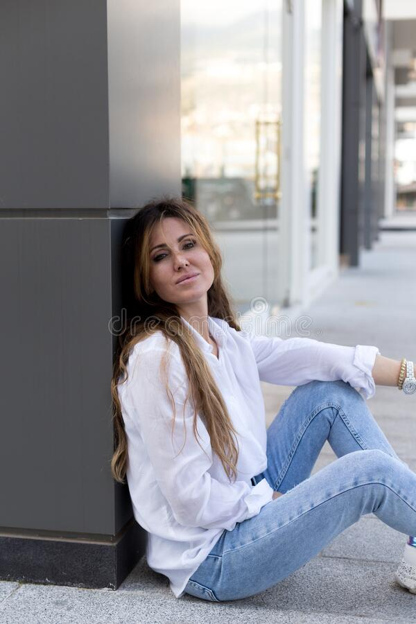 Confident female wearing casual outfit in urban environment royalty free stock photos