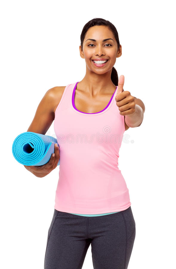 Confident Fit Woman Gesturing Thumbs Up royalty free stock photography