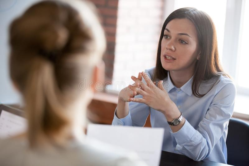 Confident focused businesswoman speaking to people at business n royalty free stock photo