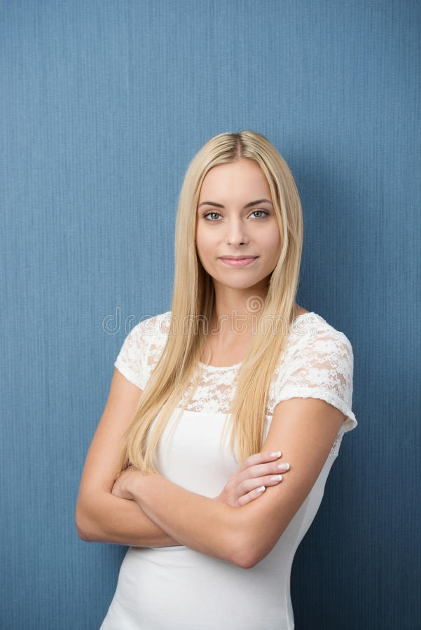 Confident friendly young woman royalty free stock photo