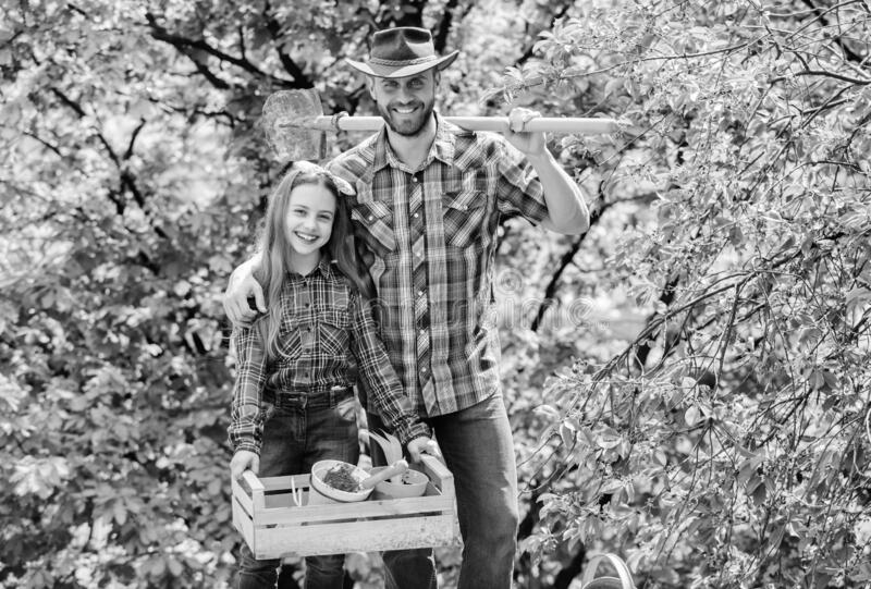 Confident gardener. father and daughter on ranch. spring village country. ecology environment. soils and fertilizers royalty free stock photo
