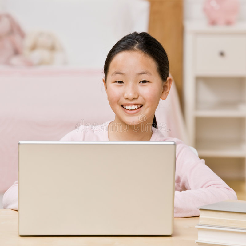 Free Confident Girl Using Laptop For Internet Royalty Free Stock Photos - 6598828