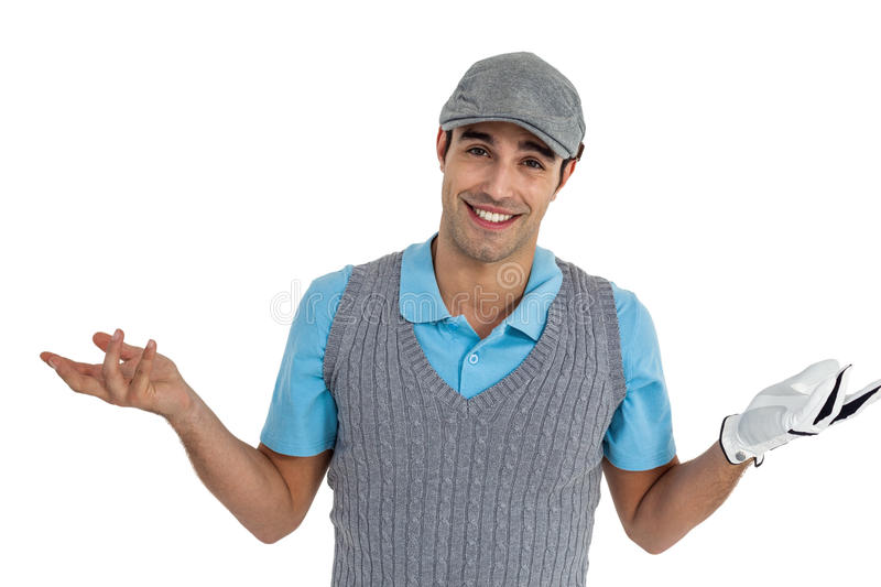 Confident golf player posing on white background stock photo